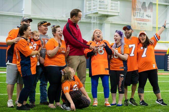 Peyton Manning surprises Linda Regis and her family at the UCHealth Training Center in Englewood.