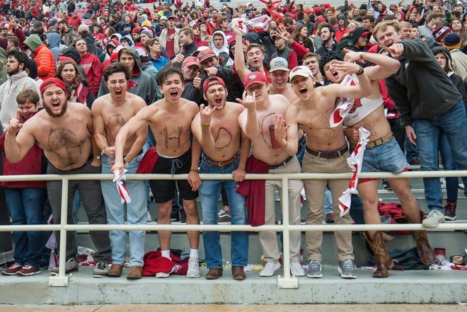 Arkansas Razorbacks students yell during a game last season.