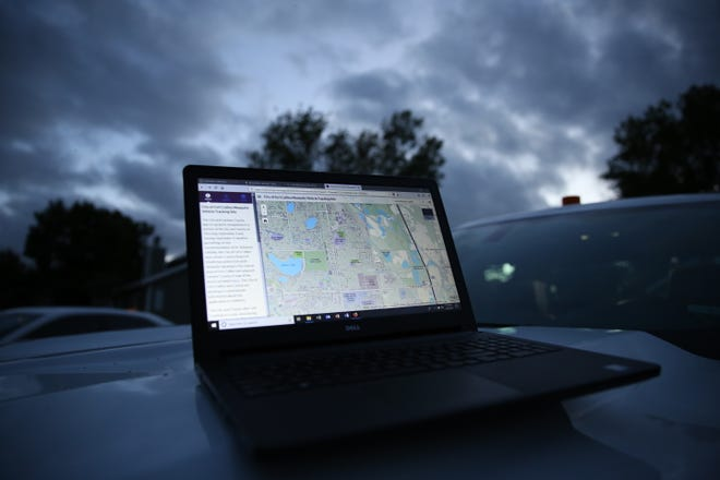 A laptop computer displays the planned spraying routes for the Vector Disease Control International mosquito spraying trucks on Sept. 6, 2018. Several trucks were spraying for mosquitos around the city.