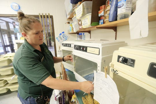 Lori Bankson, curator of animals at Bay Beach Wildlife Sanctuary works in the Green Bay animal rehabilitation center on Friday.