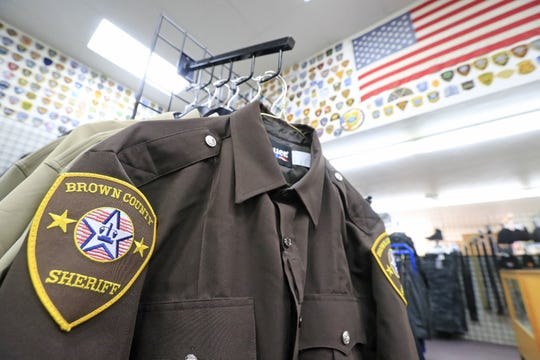 A Brown County Sheriff's Office uniform shirt on a display rack at the Uniform Shoppe on in Bellevue.