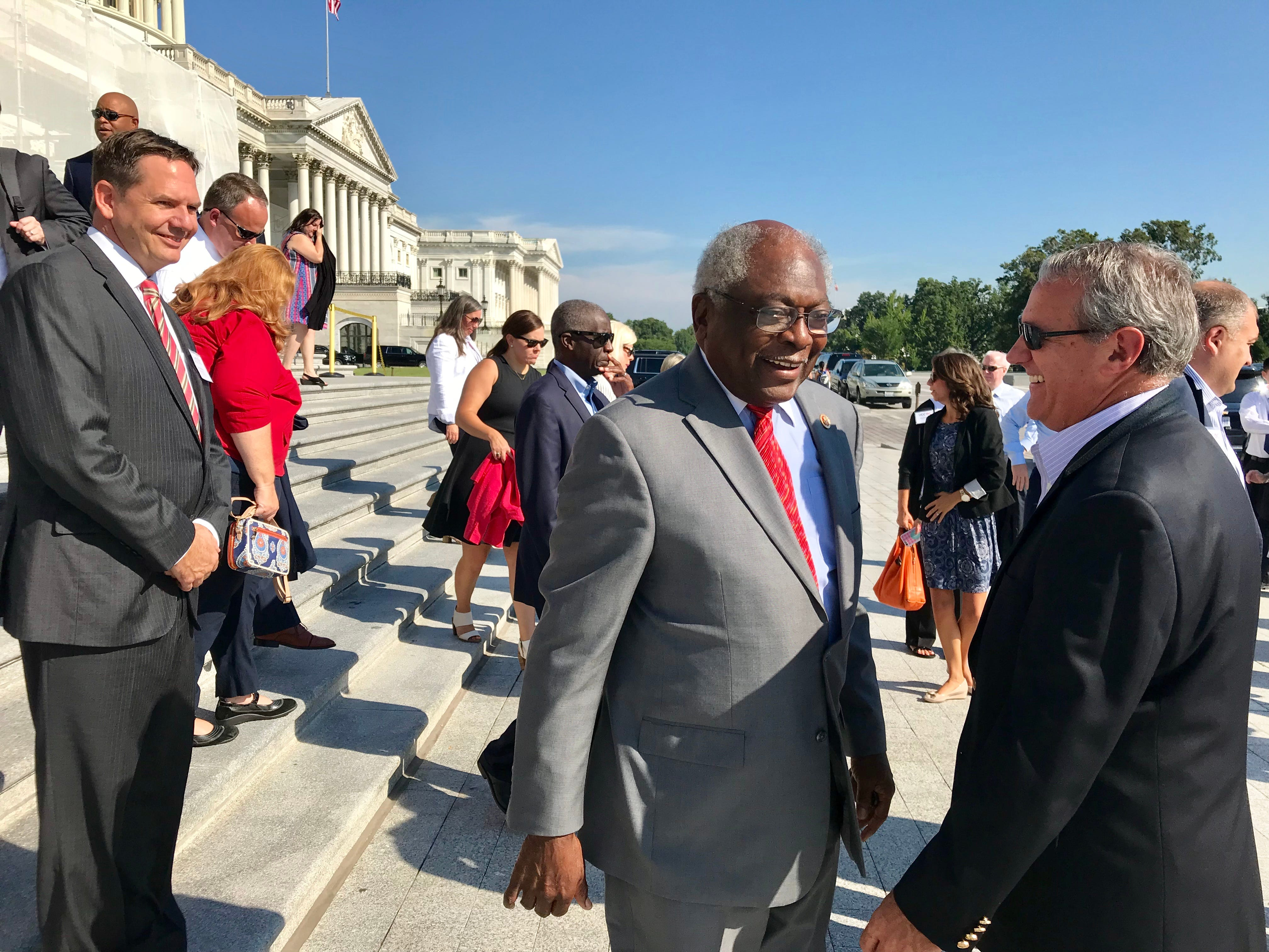 South Carolina House District 6 Rep. Jim Clyburn, center, chats with Max Metcalf, manager of government and community relations for BMW Manufacturing in Greer, on Thursday, Sept 6, 2018, on the steps of the U.S. Capitol in Washington, D.C. Metcalf was part of an Upstate Chamber Coalition delegation that visited the nation's capital this week.
