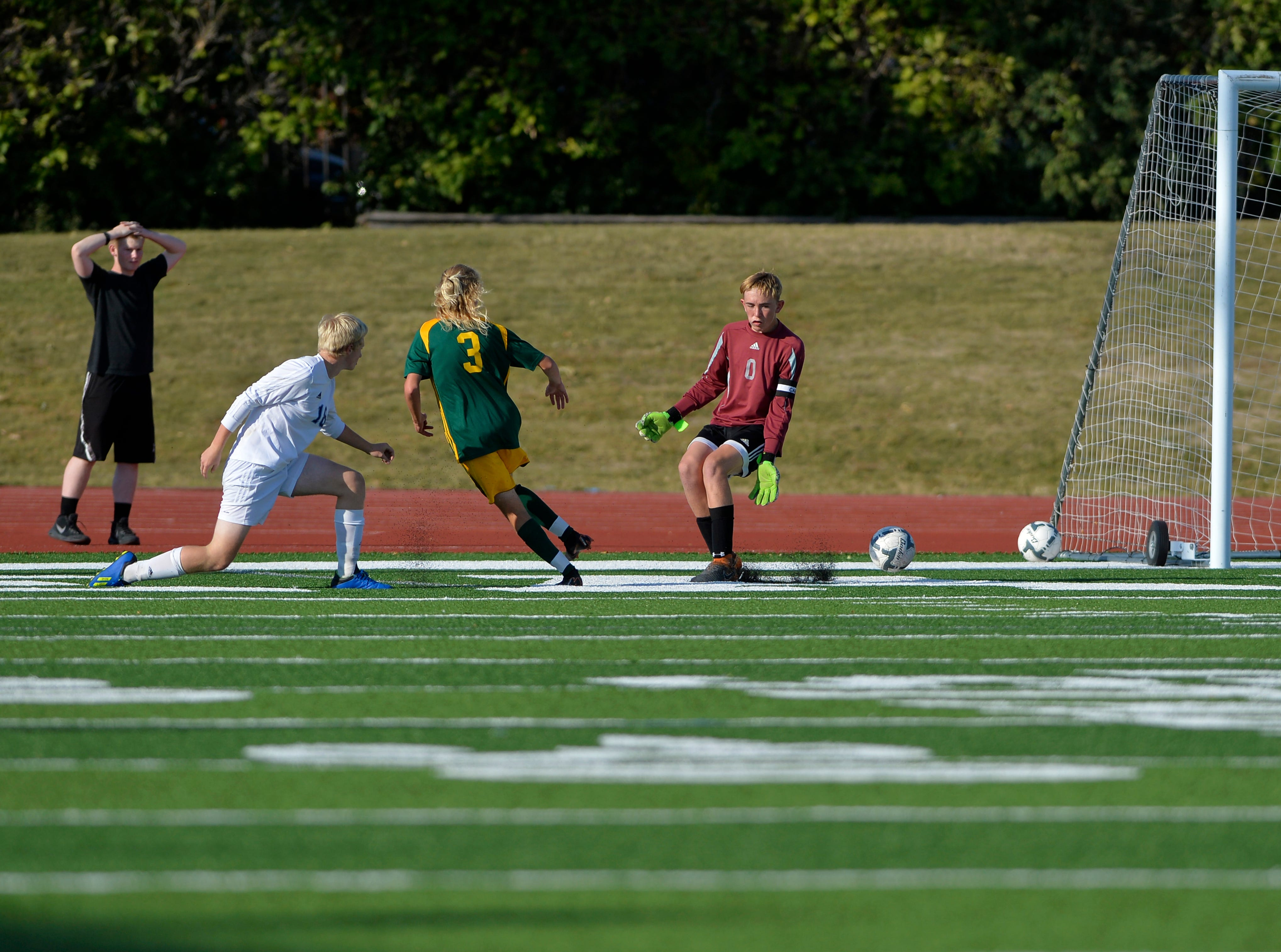 CMR's Ward Cereck, 3, slips the ball passed Great Falls High goal keeper Liam Toner for the first goal in the crosstown soccer match at Memorial Stadium, Thursday, Sept. 6, 2018.