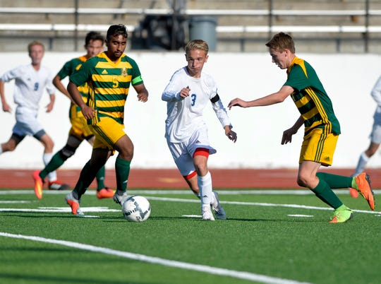 Great Falls High's Zach Langel looks for an opening in the CMR defense during the crosstown soccer match at Memorial Stadium, Thursday, Sept. 6, 2018.