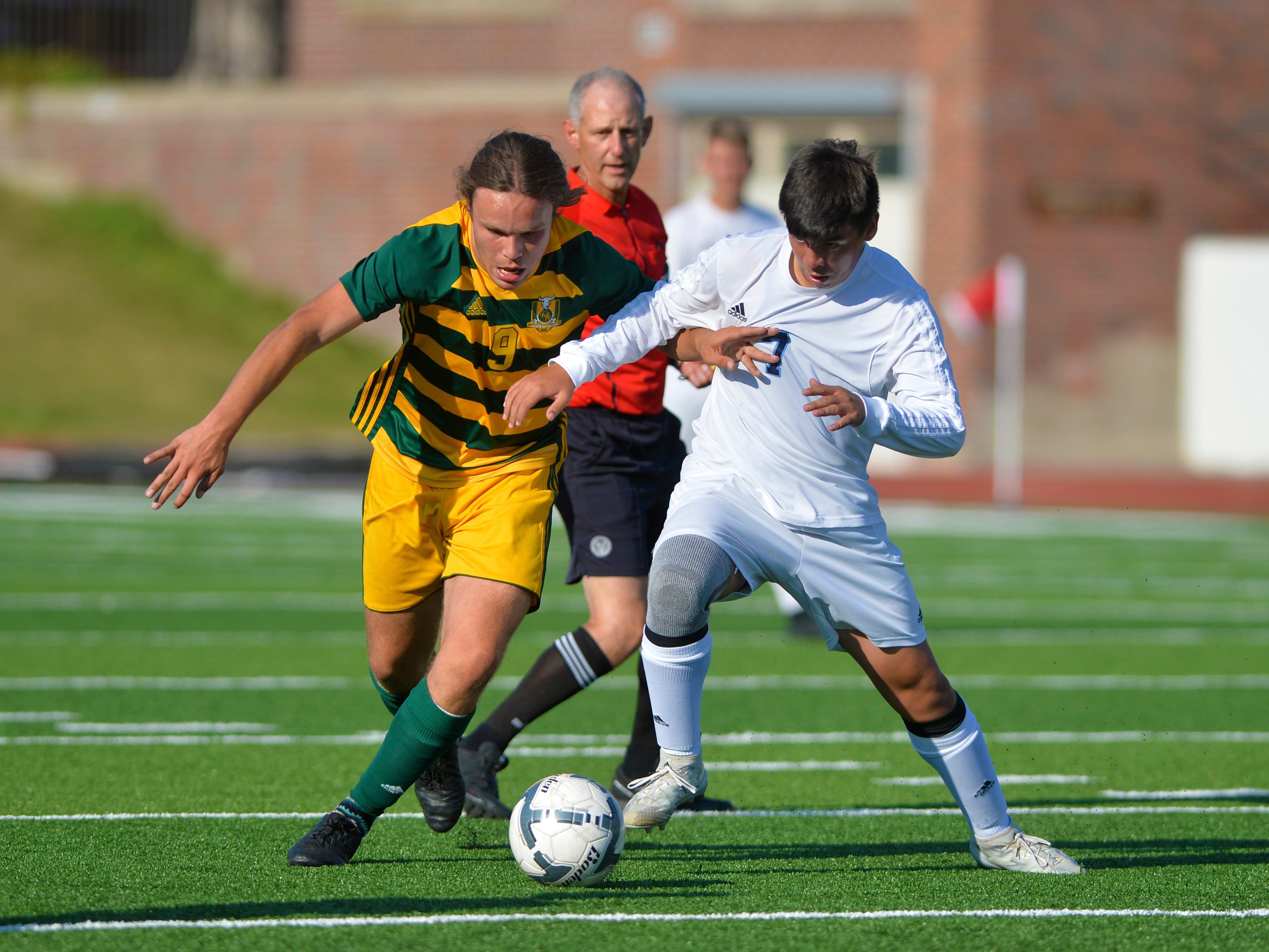 CMR's Seamus Jennings and Great Falls High's Zek Herrera battle for the ball suring the crosstown soccer match at Memorial Stadium, Thursday, Sept. 6, 2018.
