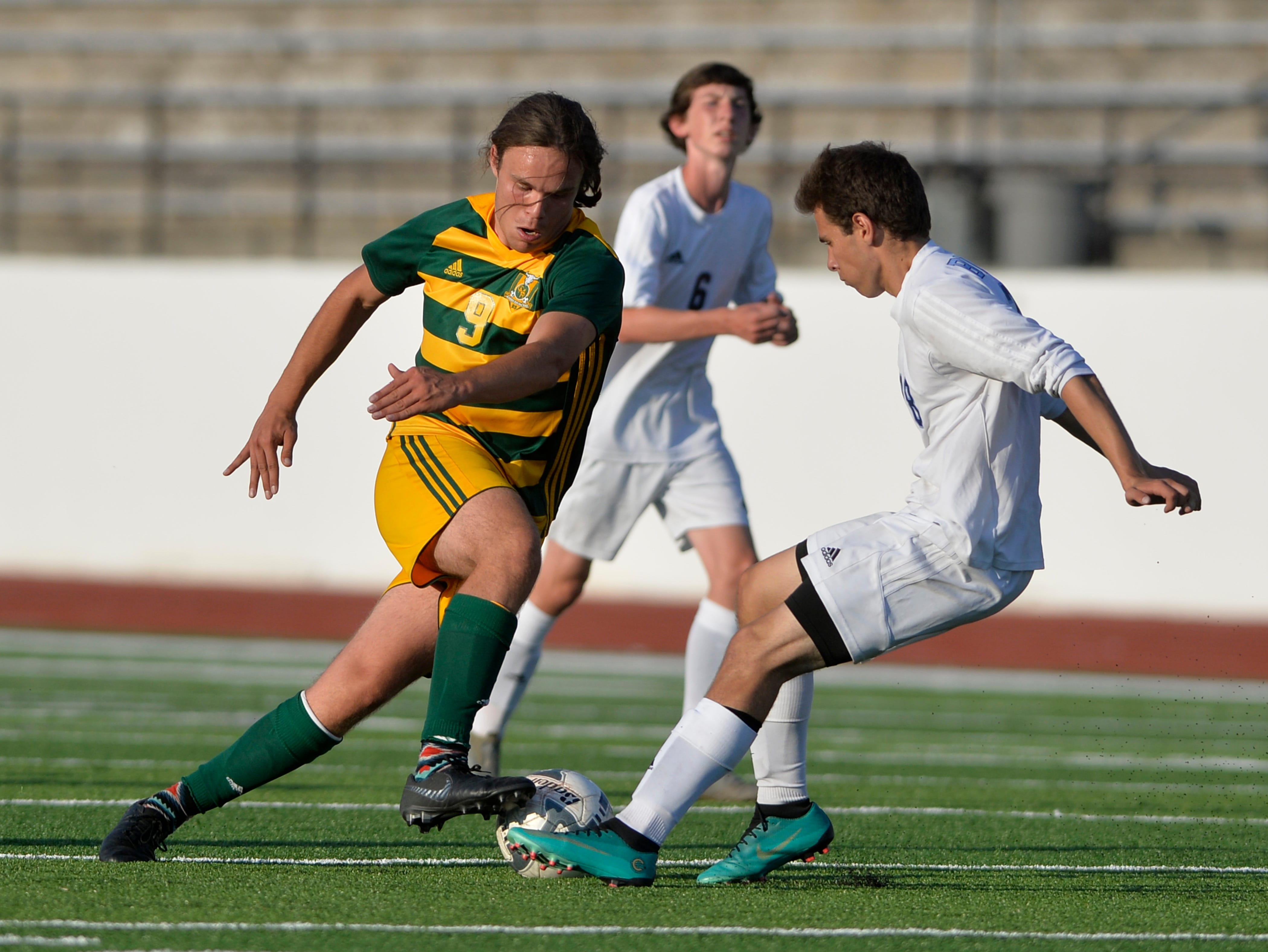CMR's Seamus Jennings attempts to get passed Great Falls High's Brian Gemberling during the crosstown soccer match at Memorial Stadium, Thursday, Sept. 6, 2018.