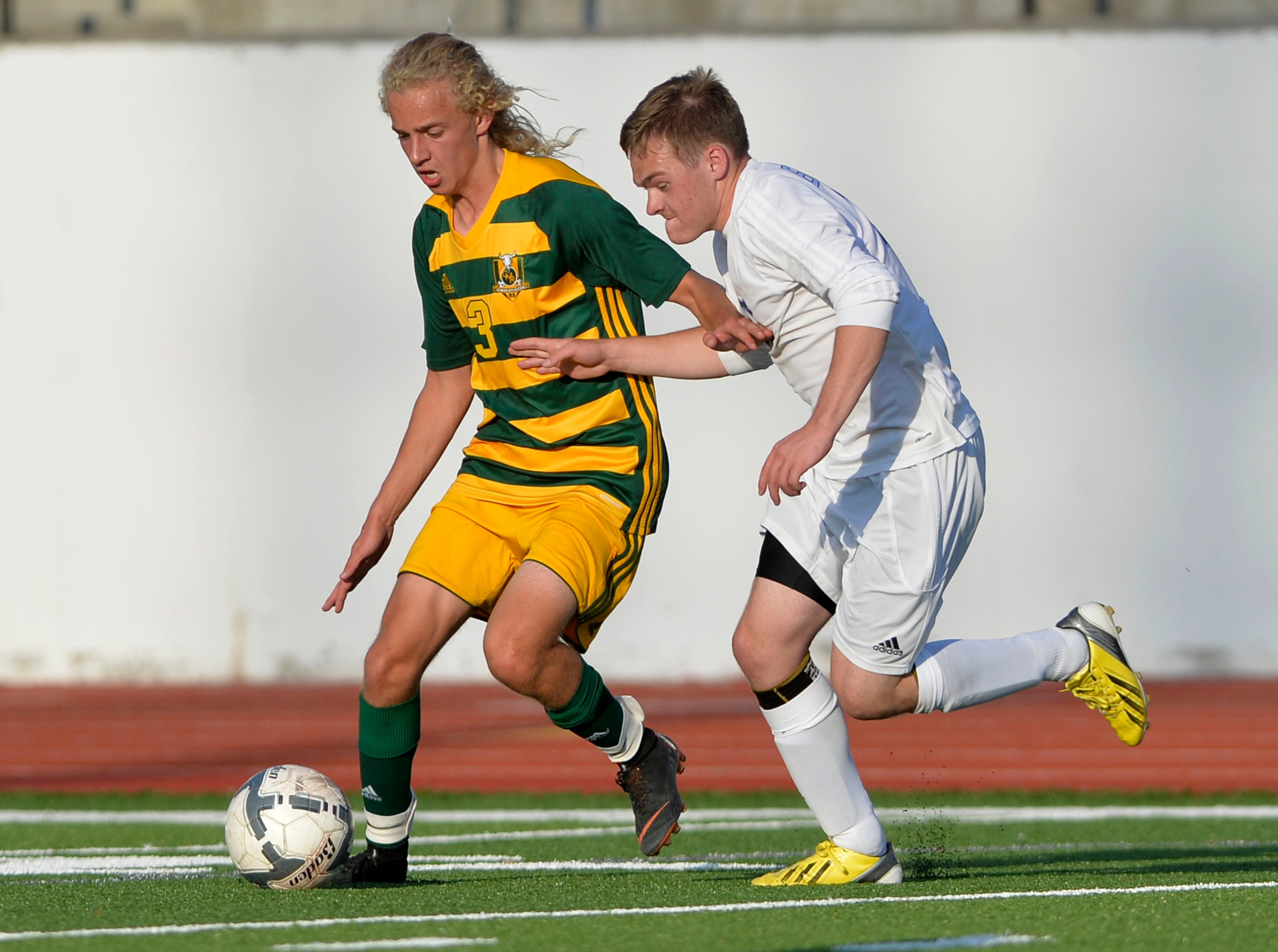 CMR's Ward Cereck attempts to keep the ball away from CMR's Alex Shandelson during the boys crosstown soccer match at Memorial Stadium, Thursday, Sept. 6, 2018.