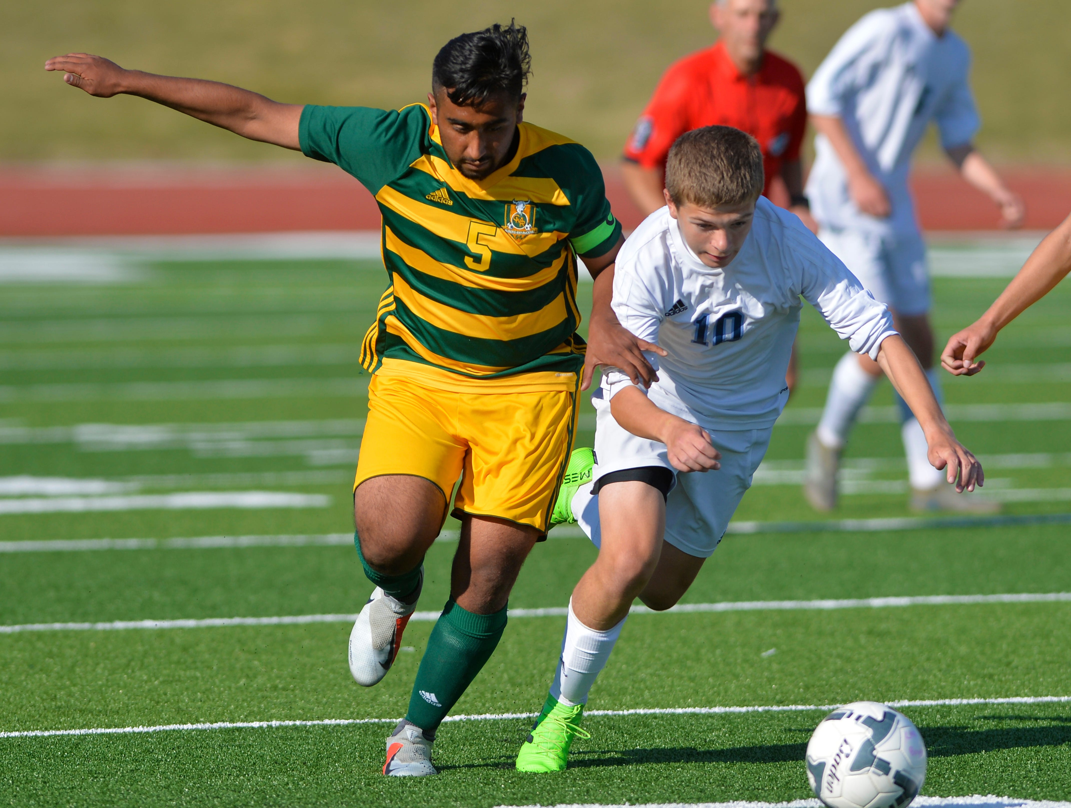 CMR's Mario Roque and Great Falls High's Corbyn Smyth work for control of the ball during the crosstown soccer match at Memorial Stadium, Thursday, Sept. 6, 2018.