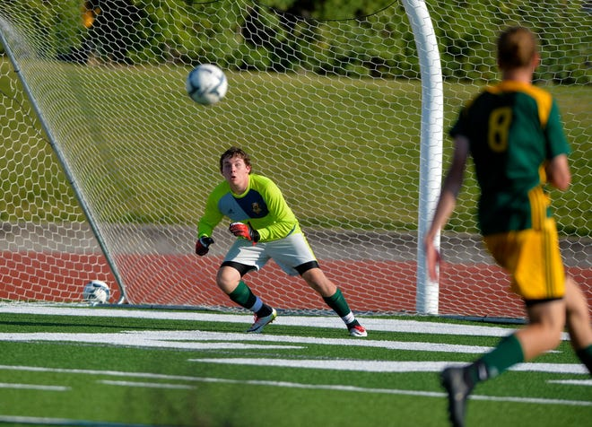 CMR goalie Tyler Golightly tracks a shot on goal during the crosstown soccer match at Memorial Stadium earlier this season. The Rustlers defeated the Bison in the second matchup of the season Tuesday 2-1.