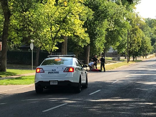 Great Falls Police Department officers apprehend an unknown suspect who fled a crash scene at the corner of 12th Street and 2nd Avenue South in Great Falls Friday.
