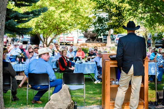 Jim Peterson, a board member for The C.M. Russell Museum and the Montana Cowboy Hall of Fame, addresses attendees at the Saddle of Honor event Friday.