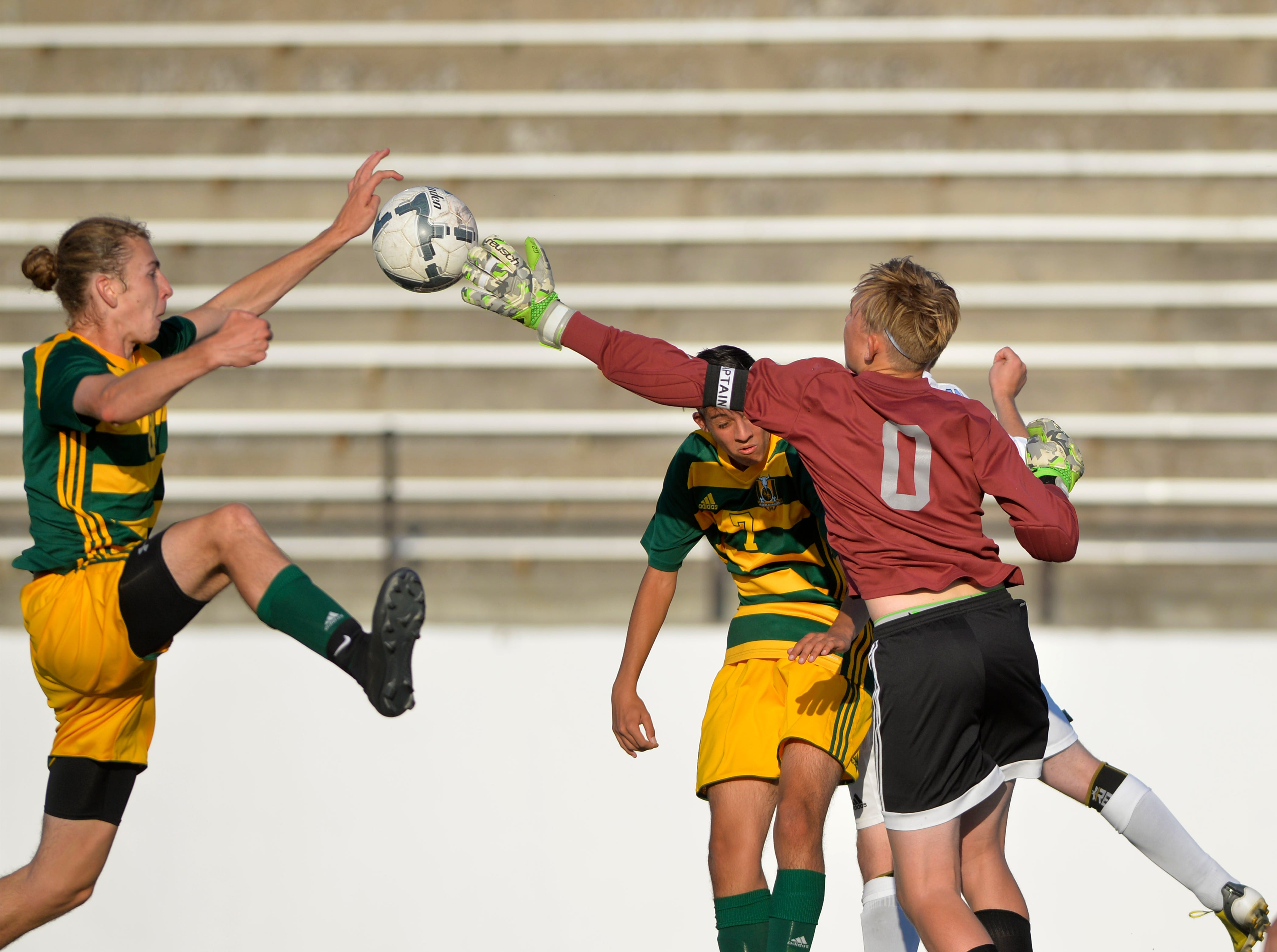 Great Falls High keeper Liam Toner attempts to knock away the ball on a cornerkick during the crosstown soccer match at Memorial Stadium, Thursday, Sept. 6, 2018.