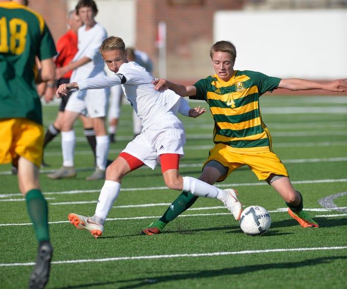 Great Falls High's Zach Langel and CMR's Matt McGraw make a play for the ball during the crosstown soccer match at Memorial Stadium, Thursday, Sept. 6, 2018.