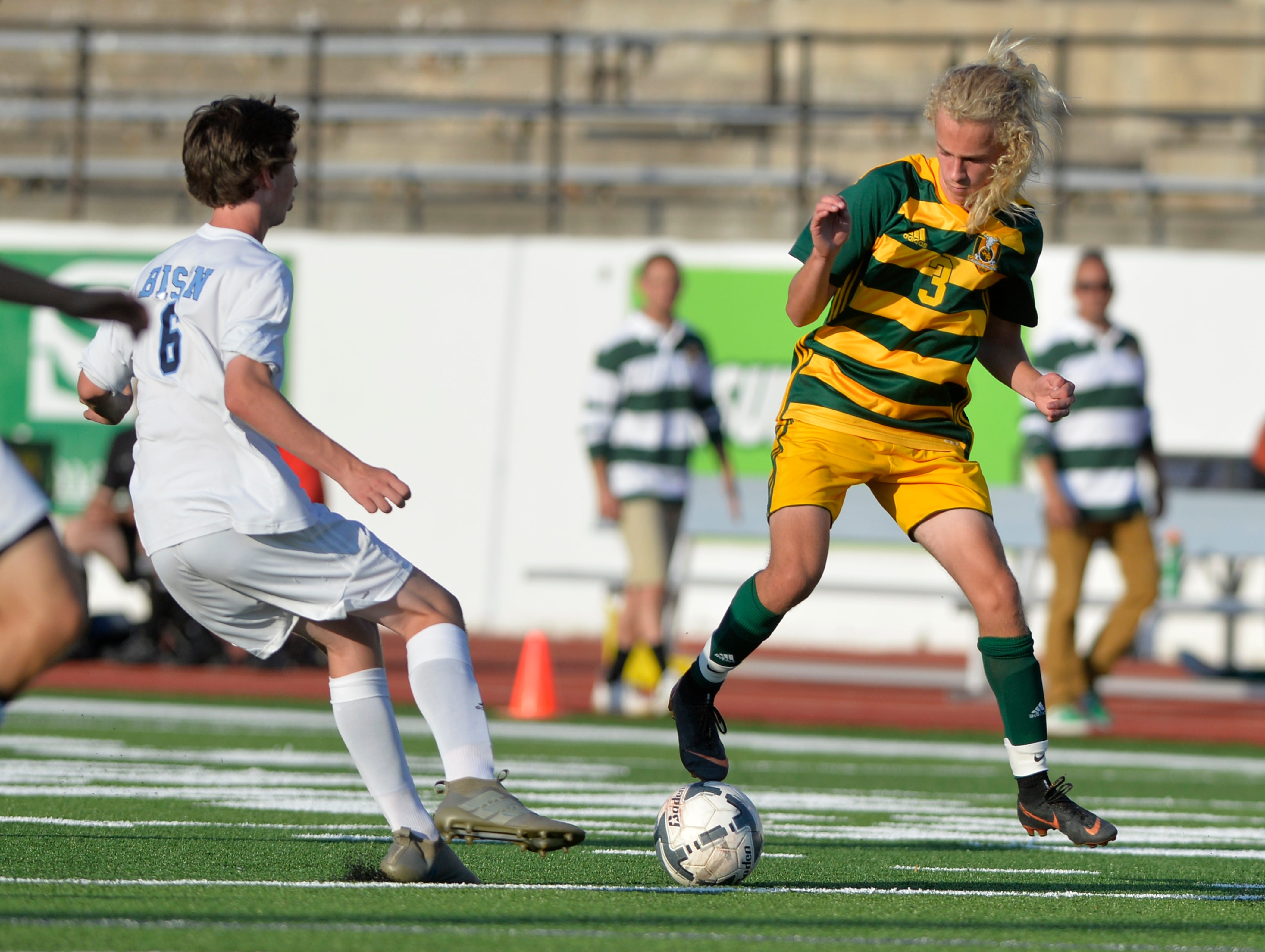 CMR's Ward Cereck attempts to keep the ball away from Great Falls High defenderJacob Murphy during the boys crosstown soccer match at Memorial Stadium, Thursday, Sept. 6, 2018.