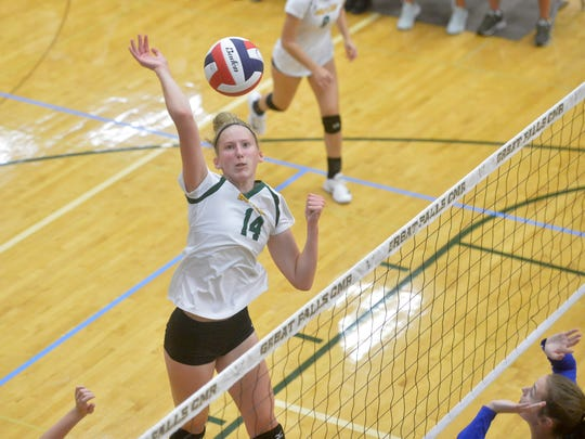 CMR's #14 spikes at the net during Friday's match against Havre in the CMR Fieldhouse.