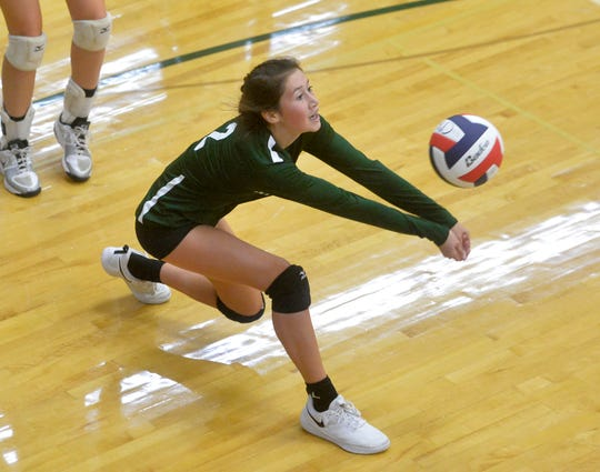 CMR's Lauren Lindseth makes a dig in Friday's match against Havre.