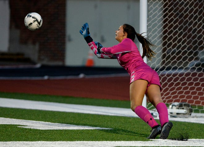 Great Falls High goalie Jorgie Hawthorne dives to make a save during last week's crosstown soccer match at Memorial Stadium. The Bison girls played to a 1-1 tie  with Billings West Friday in Billings.