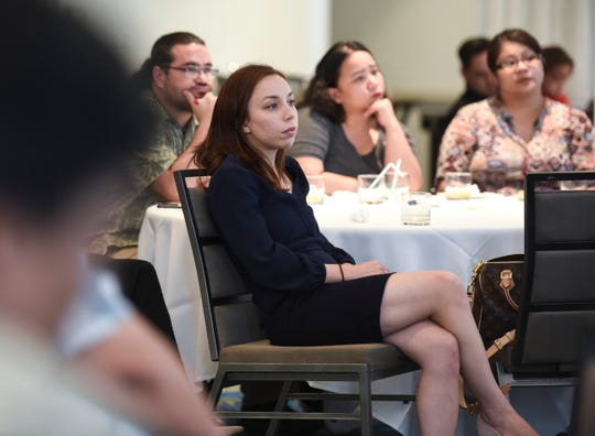 In this Sept. 7, 2018, file photo, members of the Guam Chamber of Commerce's Guam Young Professionals listen to Republican senatorial candidates during a forum at the Outrigger Guam Beach Resort.