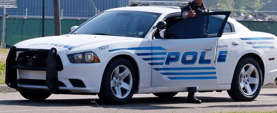 A Hattiesburg police officer exits a patrol car in this file photo.