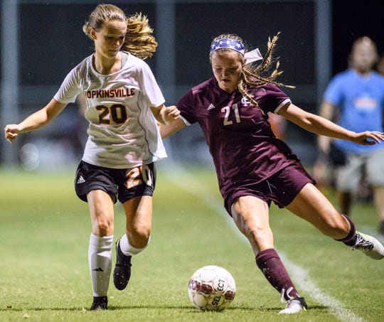 Hopkinsville's Haley Cowherd (20) and Henderson's Cecilla Palummo (21) battle for possession at Colonel Field in Henderson, Ky., Thursday, Sept. 6, 2018. The Lady Colonels defeated the Tigers 8-0.