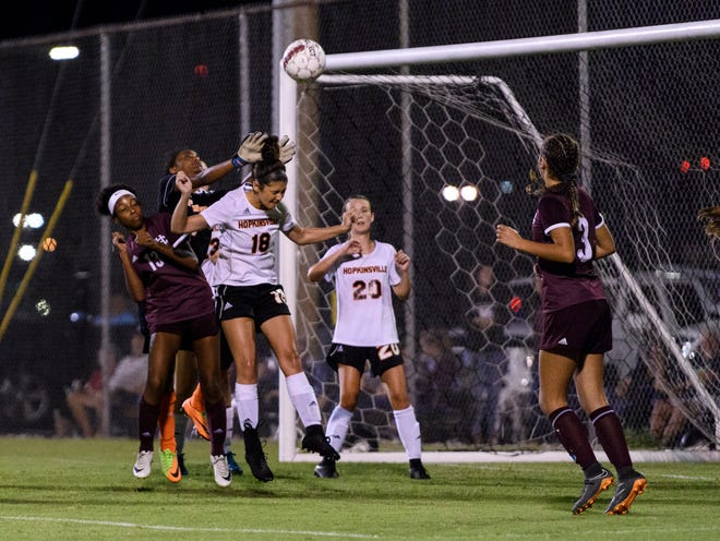Hopkinsville's Natajea Babb (1) and Hopkinsville's Keeli Miles (18) deflect a corner kick attempt by the Henderson County Lady Colonels during the second half at Colonel Field in Henderson, Ky., Thursday, Sept. 6, 2018. The Lady Colonels defeated the Tigers 8-0.