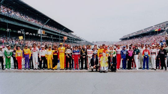 Drivers for the 1994 Brickyard 400 lined up on the start/finish line before the start of the race.