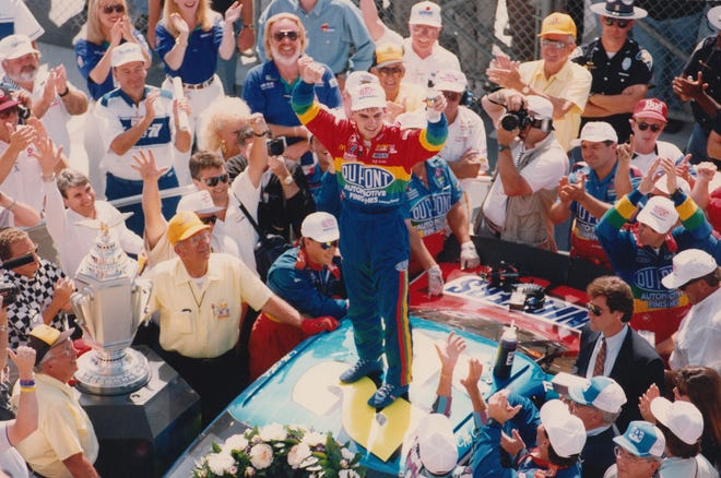 Jeff Gordon celebrated atop his car after winning the inaugural Brickyard 400 in 1994.