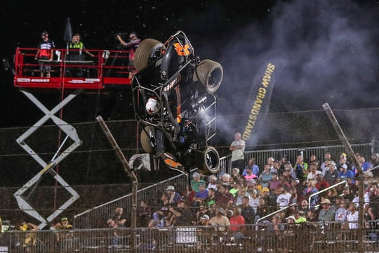 Robert Dalby, of Anaheim, Calif., flips head over heels in a nasty crash during Driven2SaveLives BC39 qualifier rounds at Indianapolis Motor Speedway, for the USAC P1 Insurance Midget National Championship, Thursday, Sept. 6, 2018.