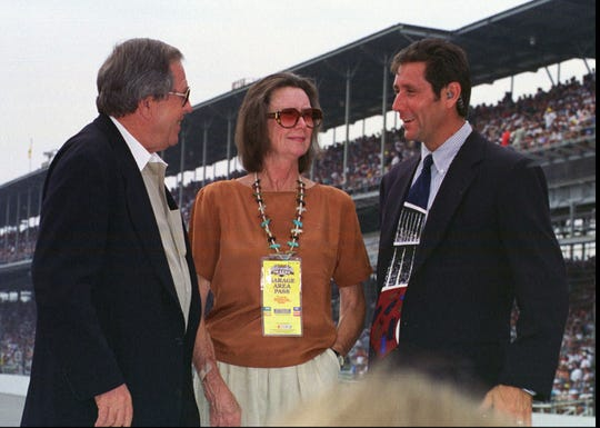 Mari Hulman George and Tony George (right) with NASCAR's Bill France during the 1997 Brickyard 400.