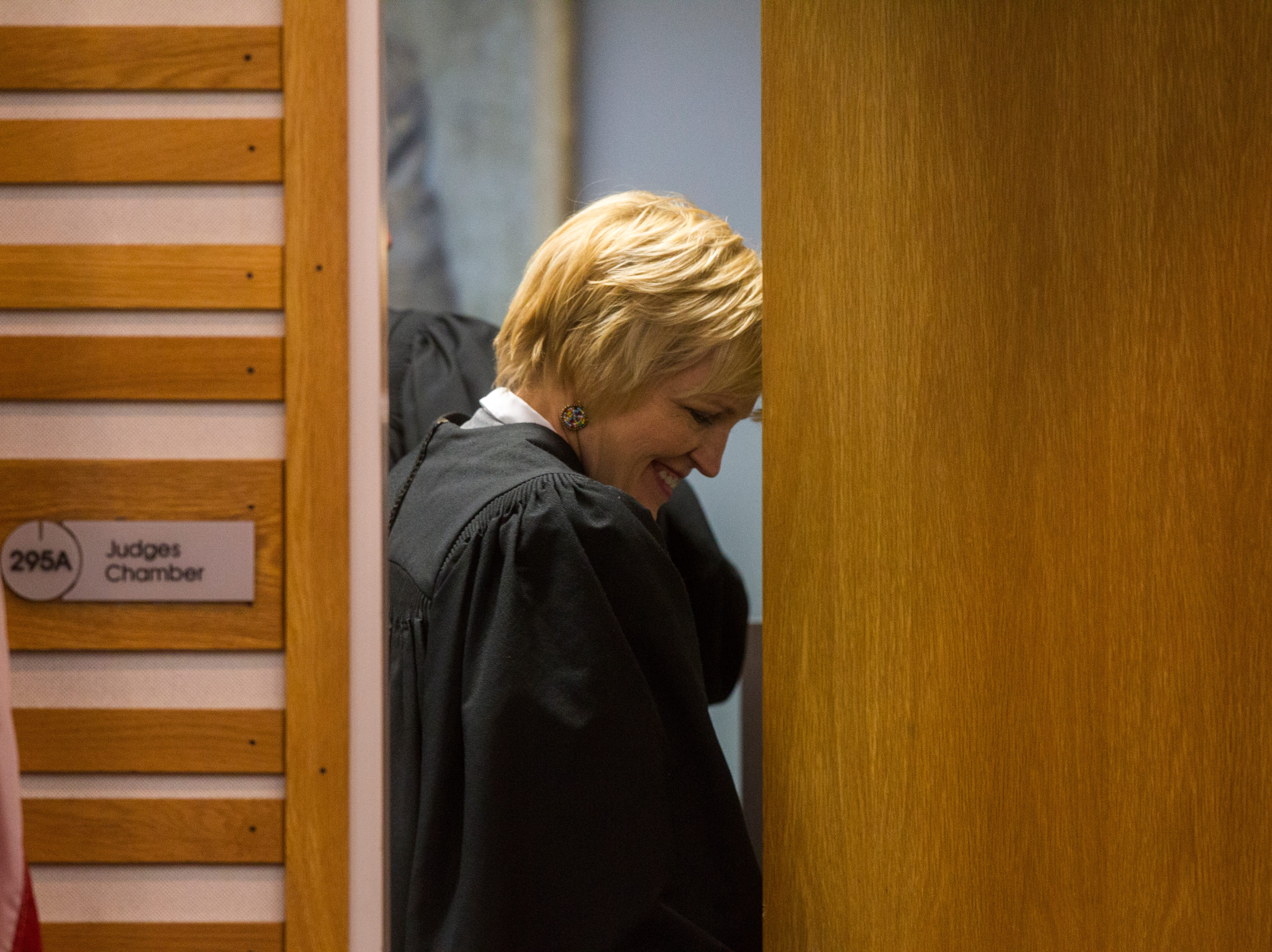 Justice Susan Christensen of the Iowa Supreme Court smiles after hearing oral arguments on Friday, Sept. 7, 2018, at Levitt Auditorium inside the Boyd Law Building on the University of Iowa campus in Iowa City.
