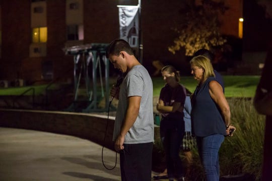 One of Slater Springman's teammates on the FHU baseball team leads a large group of students in prayer on his behalf on Sept. 5, 2018.
