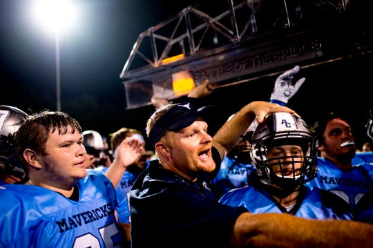 Anderson County Head Coach Davey Gillum celebrates with the team during a football game between Anderson County and Clinton at Anderson County High School in Clinton, Tennessee on Thursday, September 6, 2018.