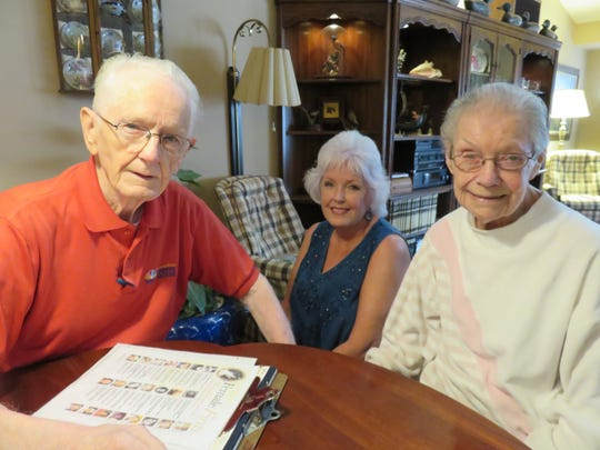 TV news station pioneers Duane Eastvold, left, and Joan Lambert, right, are shown at their home with their daughter, Terryl Oliver, on Sept. 5, 2018.