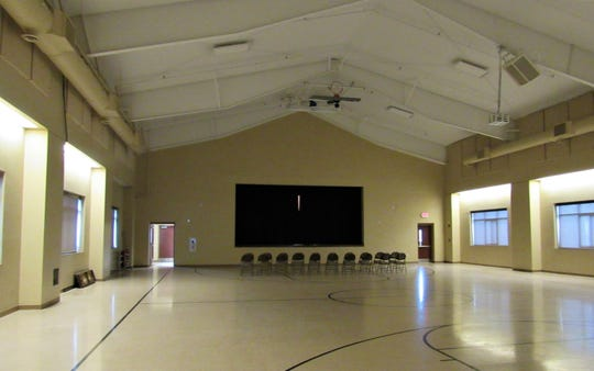 There is plenty of room in the gymnasium for all kinds of activities; the Shamrock ball may be held here after the center is completed.
