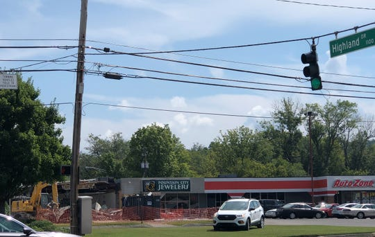 """Buildings are being demolished at the corner of Highland Drive and North Broadway in Fountain City as a City of Knoxville employee monitors traffic on Sept. 6. """"There have been many rezoning and variance requests along Broadway and Central that all go back to the key issue – our current zoning is 60 years old,"""" said Gerald Green, executive director, Knoxville-Knox County Metropolitan Planning Commission. """"We did not anticipate the current zoning. We need to provide for more development and mixed use along those corridors."""""""