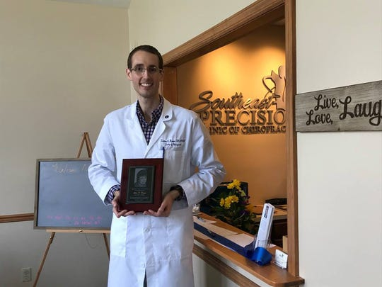 Dr. Zackery Harper dedicates his practice to his grandmother Alice Payne. Southeast Precision Clinic of Chiropractic Monday, Aug. 13, 2018.