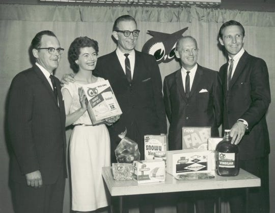 Joan Lambert Lambert hosted a Red Owl Theatre broadcast that was eventually viewed in four states and parts of Canada. Pictured are Lambert with Red Owl clients.