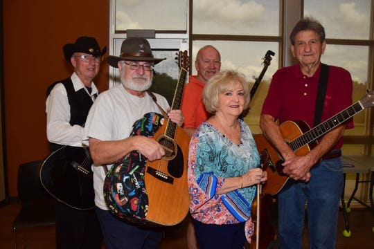 The core group of musicians who meet at Karns Senior Center the first Wednesday of the month include George Hancock on guitar, Judy Didier on fiddle, Warren Pearson on guitar; (back) J.J. Johnson on guitar and William Rasnick on banjo.