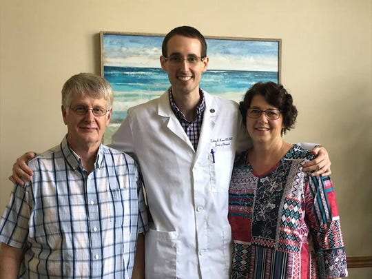Dr. Zackery Harper with his parents, Randy and Glenda Harper, at the ribbon cutting ceremony for Southeast Precision Clinic of Chiropractic on Monday, Aug. 13, 2018.