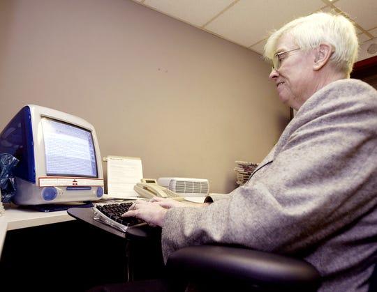 Charlie Lenox at his desk.