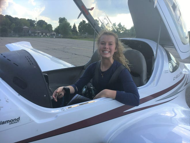 Brighton High School student Lauren Dowd after her first solo flight in a Diamond single-engine, two-seat airplane on her 17th birthday,  Tuesday, Sept. 4, 2018, at Crosswinds Aviation at the Livingston County Spencer J. Hardy Airport in Howell Township.
