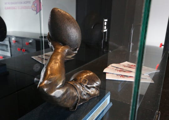 ormer U of L QB Chris Redman's Johnny Unitas Golden Arm Award is on display inside the field-level luxury suite at Cardinal Stadium.