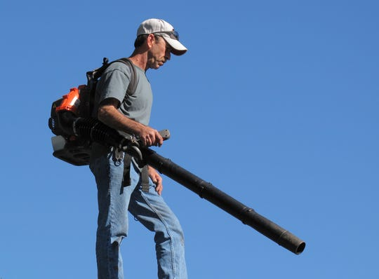 Try using a leaf blower to blow the dirt out instead of sweeping