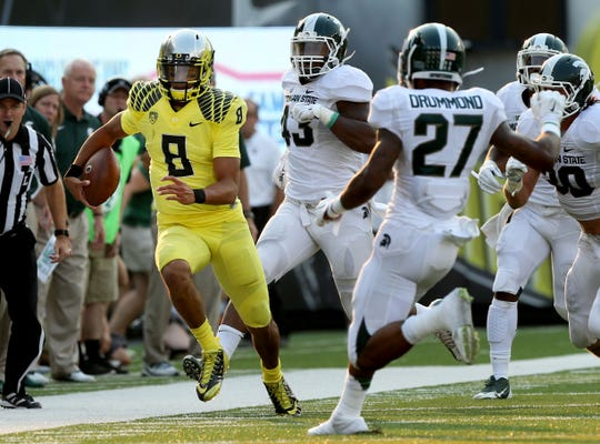 Oregon quarterback Marcus Mariota made the second half a nightmare for Michigan State in the Spartans' loss in Eugene in 2014. Oregon made the College Football Playoff that year. MSU made it the next year.