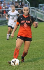 Ashland's Megan Cornell kicks the ball down the field while playing a home game against Madison on Thursday.