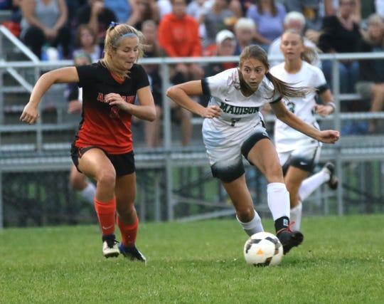 Madison's Kari Eckenwiler moves the ball down the field against Ashland's Carlie Stutzman earlier in the season.