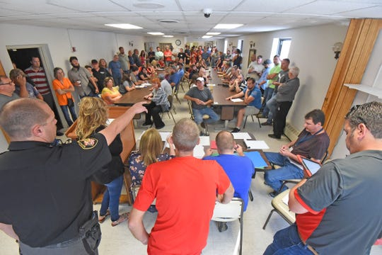 The sheriff's sale on Friday was standing room only. The auction included a property on Fifth Avenue that may include radioactive material.