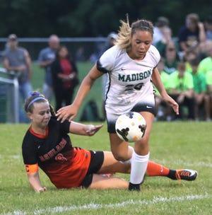 Madison's Trinity Tucker kicks the ball away from Ashland's Megan Cornell earlier this season.