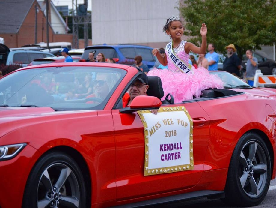 Kendall Carter, Miss Wee Pop, waves to the crowd during the Marion Popcorn Festival parade on Thursday, Sept. 6, 2018.
