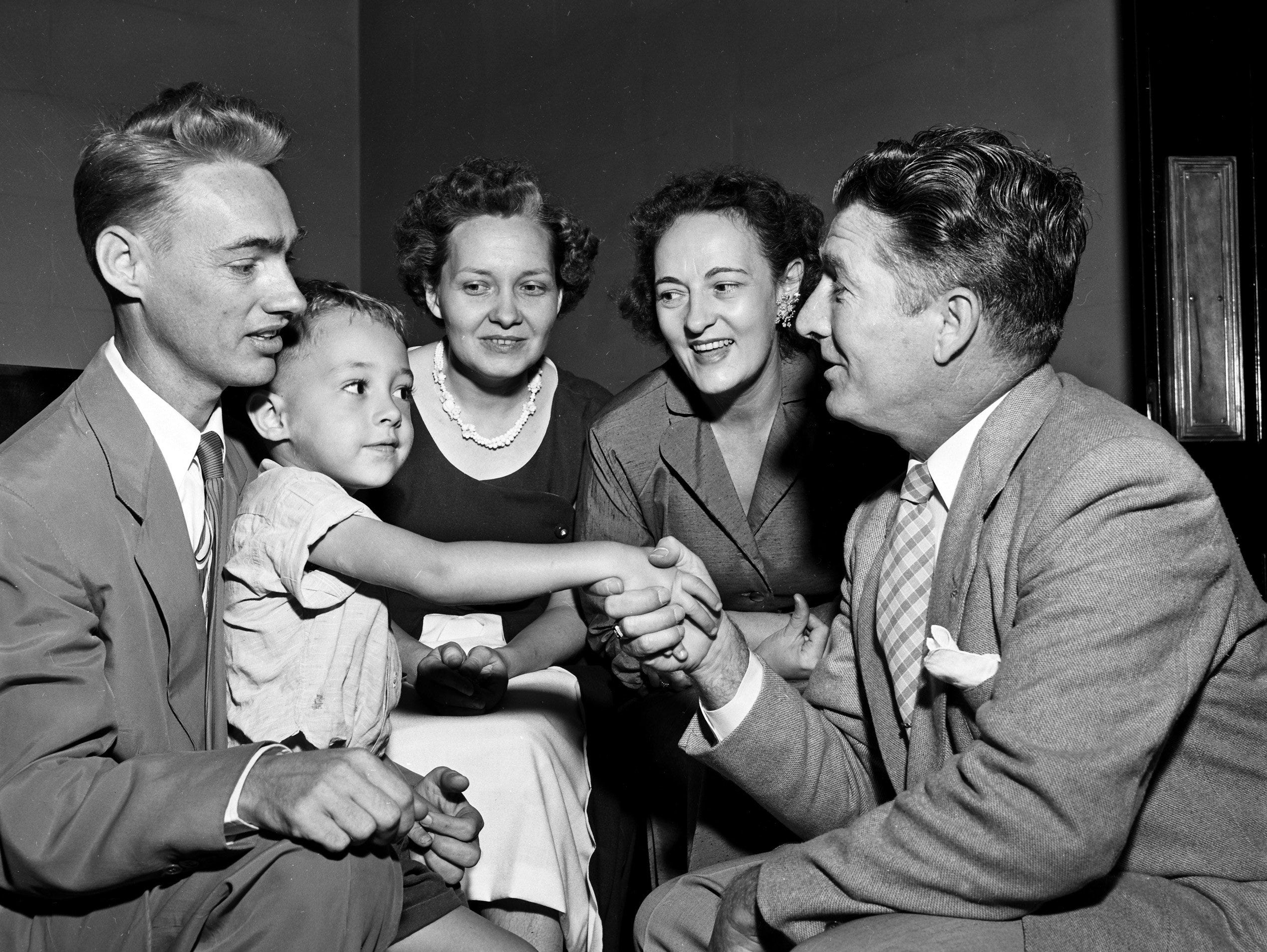 Four-year-old David Fitzpatrick was right along with his father, Earl Fitzpatrick (Left) and other members of the staff in congratulating George Herring (Right), who took the oath of office as Criminal Court clerk before Judge Perry Sellers (Not Shown) in September 1952.  Mr Firzpatrick is Mr. Herring's chief deputy clerk and Mrs. Emily Tharp (Center) and Mrs. Jewell Mottweiler (Second Right) are deputy clerks.
